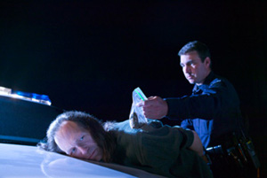 man being arrested for possession of drugs