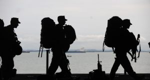 army wearing backpacks silhouette