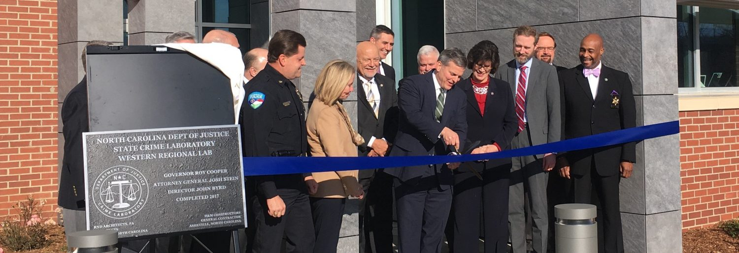 cutting the ribbon to open state crime lab